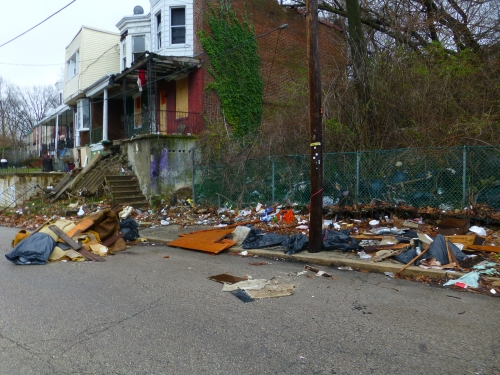459 E Price St. - Abandoned house with long history of dumping. Cleaned up by Streets Dept many times
