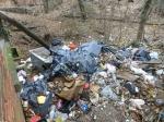 Trash accumulation on SE side of Bldg